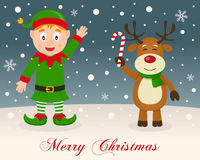 Merry Christmas - Green Elf & Reindeer. A merry Christmas greeting card with a happy green elf smiling and a cute reindeer holding a candy cane in a snowy Stock Photos