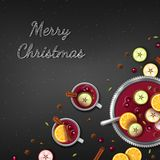 Merry Christmas Greeting Background. Winter traditional drink punch in a bowl and cups, slices of oranges, apples, spices. Cardamom, cinnamon, anise, berries Stock Photos