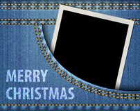 Merry Christmas greeting and blank photo frame in blue jeans poc Stock Photos