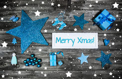 Merry christmas greeting card in blue and white with a wooden si Stock Photo