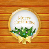 Merry Christmas greeting card  with christmas tree and golden bow. Christmas tree branches on wooden background. Vector illustration Stock Photography