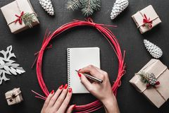 Merry Christmas greeting card concept with space for text, woman writing letter to Santa Claus. Stock Photos