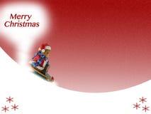 Merry Christmas. Greeting card with a cute teddy bear on a snow sledge Stock Image