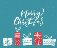 Merry Christmas greeting card design with hand drawn illustrations of gift boxes. White text on blue background.  Royalty Free Stock Photo