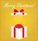 Merry Christmas Greeting Card Gift Box with Bauble Golden Background Stock Image