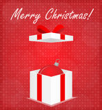 Merry Christmas Greeting Card Gift Box with Bauble Red Background Stock Photo