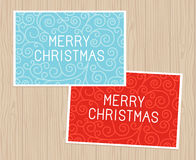 Merry christmas greeting card. Merry christmas hand lettering in outline style - greeting card with decorative typography and line flourishes on blue wooden Royalty Free Stock Images