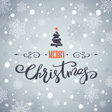 Merry Christmas greeting card. Holiday lettering design. Merry Christmas greeting card with Christmas tree and snowflakes. Holiday lettering design Stock Images