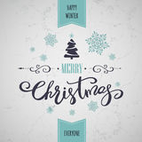 Merry Christmas greeting card. Holiday lettering design. Merry Christmas greeting card with Christmas tree and snowflakes. Holiday lettering design Royalty Free Stock Photo