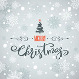 Merry Christmas greeting card. Holiday lettering design. Merry Christmas greeting card with Christmas tree and snowflakes. Holiday lettering design Royalty Free Stock Images