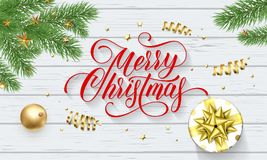 Merry Christmas greeting card of holy and fir tree wreath. Merry Christmas greeting card of holy and fir tree wreath and gift in golden ribbon bow on snow Royalty Free Stock Image