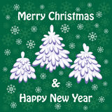 Merry Christmas greeting card. With the image of small fir-trees Royalty Free Stock Photography