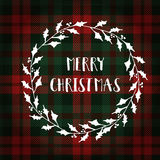 Merry Christmas greeting card, invitation. White Christmas wreath made of holly. Hand lettered text. Tartan checkered plaid. Stock Photos