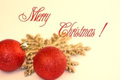 Merry Christmas greeting card. With red balls and snowflake on background Stock Images