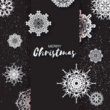 Merry Christmas Greeting card with Origami Snowflake on black background. Stock Photos