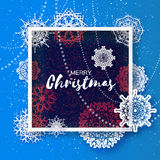 Merry Christmas Greeting card. Origami Snowflake on blue background Stock Image