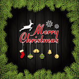 Merry Christmas Greeting Card With Ornaments On A Dark Wood Board Stock Photos