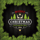 Merry Christmas Greeting Card With Ornaments On A Dark Wooden Board Royalty Free Stock Photo