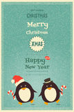 Merry Christmas greeting card with penguins Royalty Free Stock Photos