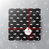 Merry Christmas greeting card. Realistic black gift box with tag Royalty Free Stock Image