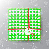 Merry Christmas greeting card. Realistic green gift box with tag Stock Photo