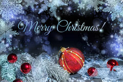 Merry Christmas, greeting card. With red baubles, frosted twigs and shiny snowflakes Royalty Free Stock Photo