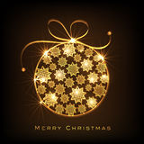 Merry Christmas greeting card with shiny X-mas Ball. Shiny golden Xmas Ball decorated by stars for Merry Christmas celebration on brown background Royalty Free Stock Photo