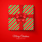 Merry Christmas Greeting Card with Striped Gift Box. Stock Image
