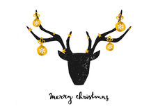 """Merry Christmas Greeting Card. Template. A black deer head decorated with gold Christmas baubles on white background. Hand lettered """"Merry Christmas"""" text Stock Image"""