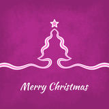 Merry Christmas Greeting Card. With tree created from a ribbon on purple background Stock Photography