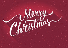 Merry Christmas Greeting card with vintage handlettering typography on red background. Royalty Free Stock Photo