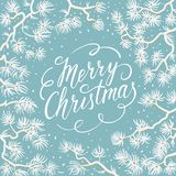 Merry Christmas greeting card. White spruce branches on a blue background. Merry Christmas hand lettering inscription with frame of snowy branches. Vector Stock Photos