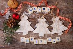 Merry christmas greeting card on wooden background Stock Photo