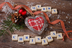 Merry christmas greeting card on wooden background Stock Photography