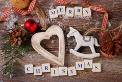 Merry christmas greeting card on wooden background Royalty Free Stock Image
