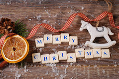 Merry christmas greeting card on wooden background Stock Photos