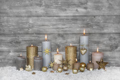 Merry christmas greeting card: wooden grey shabby chic background with candles. royalty free stock photography