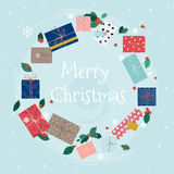 Merry Christmas greeting cards. Wreath of colorful gifts on snow Stock Images