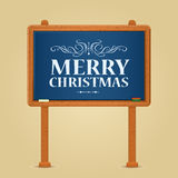 Merry Christmas Greeting on Green Chalkboard Stock Photo