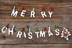 Merry Christmas greeting message on wooden background Royalty Free Stock Images