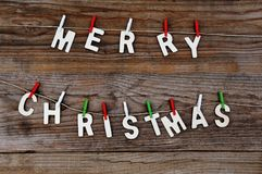 Merry Christmas greeting message on wooden background Royalty Free Stock Photos