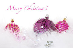 Merry Christmas Greeting with Purple. Ornaments, ribbon, and the words Merry Christmas Stock Image