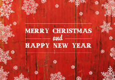 Merry Christmas Greeting On Red Planks Texture Stock Image
