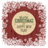 Merry Christmas greeting on red wooden background Royalty Free Stock Photo