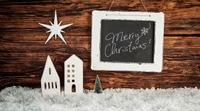 Merry Christmas greeting with star over buildings stock photos