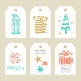 Merry Christmas greeting tags set. Hand lettering in golden, mont, coral and black colors. Trendy typography design for cards, labels, badges, posters, banners Stock Photos