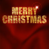 Merry christmas. Christmas greeting written with gold powder on a red background Royalty Free Stock Photography