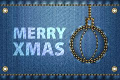 Merry Christmas greetings on blue jeans background. Stock Image