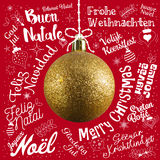 Merry Christmas greetings card from world in different languages. With golden ball tree, calligraphic text and font handwritten lettering Royalty Free Stock Image