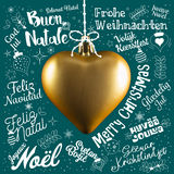 Merry Christmas greetings card from world in different languages. With golden heart, calligraphic text and font handwritten lettering Royalty Free Stock Photo